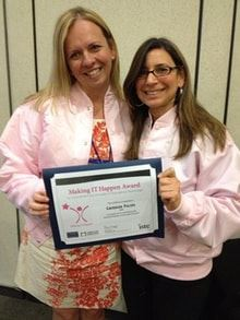 Catherine Poling, left, is shown being presented the 2013 Making IT Happen Award by Hilary Goldman of ISTE.